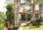 Location vacances  Botswana - Cycad Palm Guest House-4