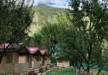 Location vacances Shimla - Tirthan village huts-4
