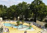 Camping avec Ambiance club Billiers - Camping Le Chateau du Petit Bois-1