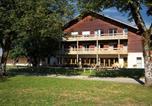 Location vacances  Jura - Domaine Odesia Les Maisons Bois - Les Crozats