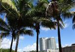 Location vacances Homestead - Ocean Million Dollar View Studio + Balcony #1-2