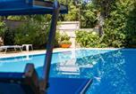 Location vacances  Province de Rimini - Appartamento a pochi passi dal mare con piscina-1