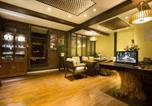 Location vacances Lijiang - Lijiang Gui Yuan Tian Ju Guesthouse-4