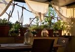 Location vacances  Province de Lucques - Barefoot Apartment-1