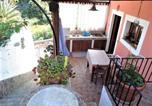 Location vacances  Ville métropolitaine de Messine - Casa I 2 Fiori - ampi terrazzi vista mare e giardino-2
