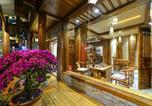 Location vacances Zhangjiajie - River View Wooden Guesthouse-4