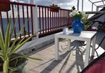 Location vacances  Province de Reggio de Calabria - Ionio Sea Apartment-2