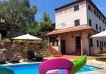 Location vacances  Province de Lucques - Appartamento Il Riccio in Versilia-1
