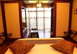 Location vacances  Chine - Oriental Garden Guest House-1