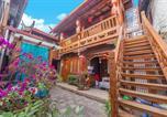 Location vacances Lijiang - Yingluo Guest House-1