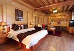 Location vacances Lijiang - Zhenmei Holiday Inn-1
