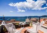 Location vacances  Province de Sassari - Panorama Guest House-1