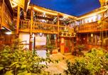 Location vacances Lijiang - Colorful Stone Guesthouse-4