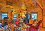 Location vacances North Canton - Rustic Dundee Cabin with Hot Tub and Forest Views!-4