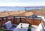 Location vacances  Province de Brescia - Attico di lusso vista lago-3