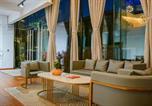 Location vacances Lijiang - Floral Hotel Zaiyiqi-4
