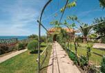 Location vacances  Province d'Oristano - Three-Bedroom Apartment in Porto Alabe-1