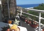 Location vacances  Réunion - Beau T3 65m2 Vue mer et montagne 1min plage avec parking privé-1