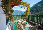 Location vacances Finkenberg - Comfortable Apartment in Mayrhofen with Garden-1
