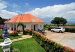 Location vacances Kampala - Victoria Lake View Guesthouse & Safaris-1
