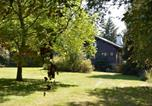 Location vacances  Belgique - Chalet in the countryside, beautiful large garden, absolute calm, total privacy-4