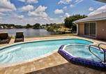 Location vacances Punta Gorda - Port Charlotte Home with Views, Heated Pool and Spa!-1