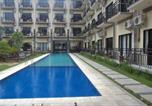 Location vacances Kuta - The Aromas of Bali Hotel & Residence-1