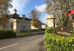 Location vacances Enniskillen - Gate lodge at Lough Erne Golf Village-1