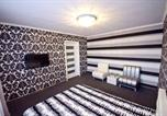 Location vacances  Moldavie - Apartment in City Center-1