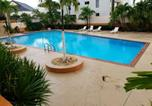 Location vacances  Porto Rico - Beautiful remodeled condominiun with an impecable view to the beach and city avenues walk distance to the beach-4