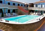 Location vacances  Province de Sassari - Locazione Turistica Le terrazze del mare-13-2