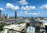 Location vacances Annerley - South Bank River and City view Apartment-2