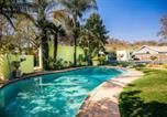 Location vacances Pretoria - Kareeblom Guesthouse & Conference Centre-1