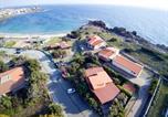 Location vacances  Province de Carbonia-Iglesias - La Baia Casa Vacanze-1