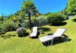 Location vacances  Province de Côme - Appartamento Giardino-2