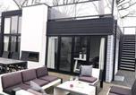 Location vacances Lelystad - Cube Elite mit Meerblick am Strand im Droompark Bad Hoophuizen-2