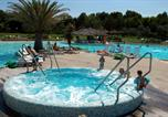 Camping avec Ambiance club Tomino - Le Capanne-4