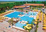 Camping avec Quartiers VIP / Premium Italie - Village Portofelice-1