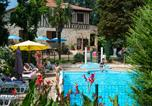 Camping avec Piscine Gondrin - Le Domaine du Castex - Camping & Hébergement-1
