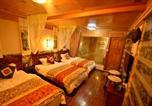 Location vacances  Chine - Shuimu Yangguang Inn-4
