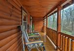 Location vacances North Canton - Rustic Dundee Cabin with Hot Tub and Forest Views!-2
