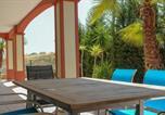 Location vacances  Huelva - (Tou001) Bonito Apartamento con Gran Jardín Solead-1