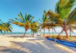 Location vacances  Belize - Blue Water Beach Villas-1