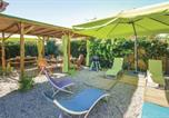 Location vacances Linguizzetta - Three-Bedroom Holiday Home in Cervione-4