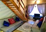 Location vacances Barberton - The Owls Thatch Guestcottage-1