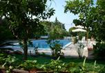 Location vacances Trabia - Apartment in villa with pool and garden-2