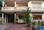 Location vacances  Cambodge - Queen Na Guesthouse-1