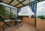 Location vacances  Province de Livourne - Villa Carol bilo M-1