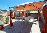 Location vacances  Province du Medio Campidano - La Casa Rosada Arbus-3