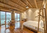 Location vacances Zhangjiajie - River View Wooden Guesthouse-1